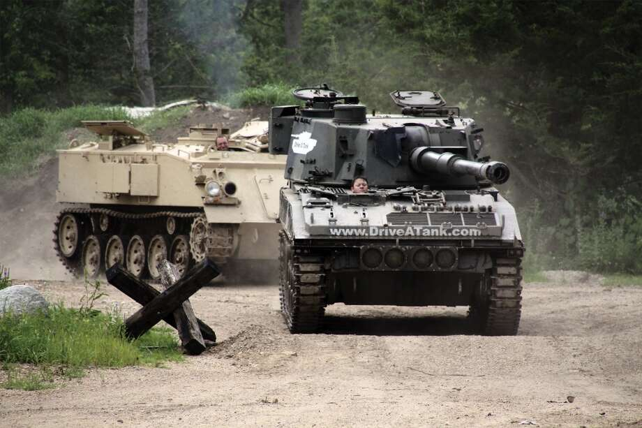 An Abbot self-propelled gun, followed by an armored personnel carrier at the Drive A Tank facility in Kasota, Minn. (All photos courtesy of driveatank.com)