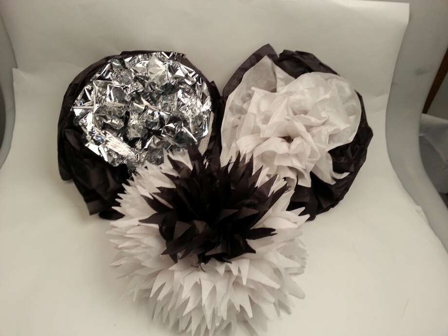 If you're having a Spurs viewing party, try making paper flowers in classic silver and black or white. Photo: Emily Spicer, San Antonio Express-News