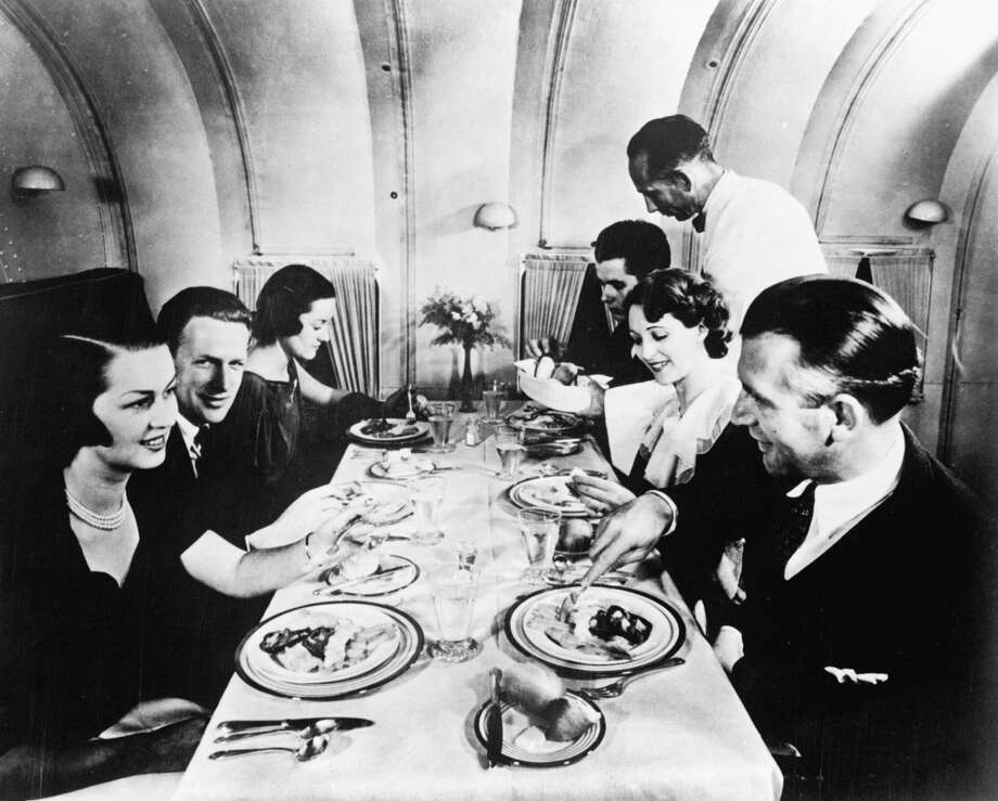 Passengers took cocktails at their seats before entering the dining lounge of the Martin M-130. Until 1944, only males were hired as attendants on overseas flights. Photo: UML