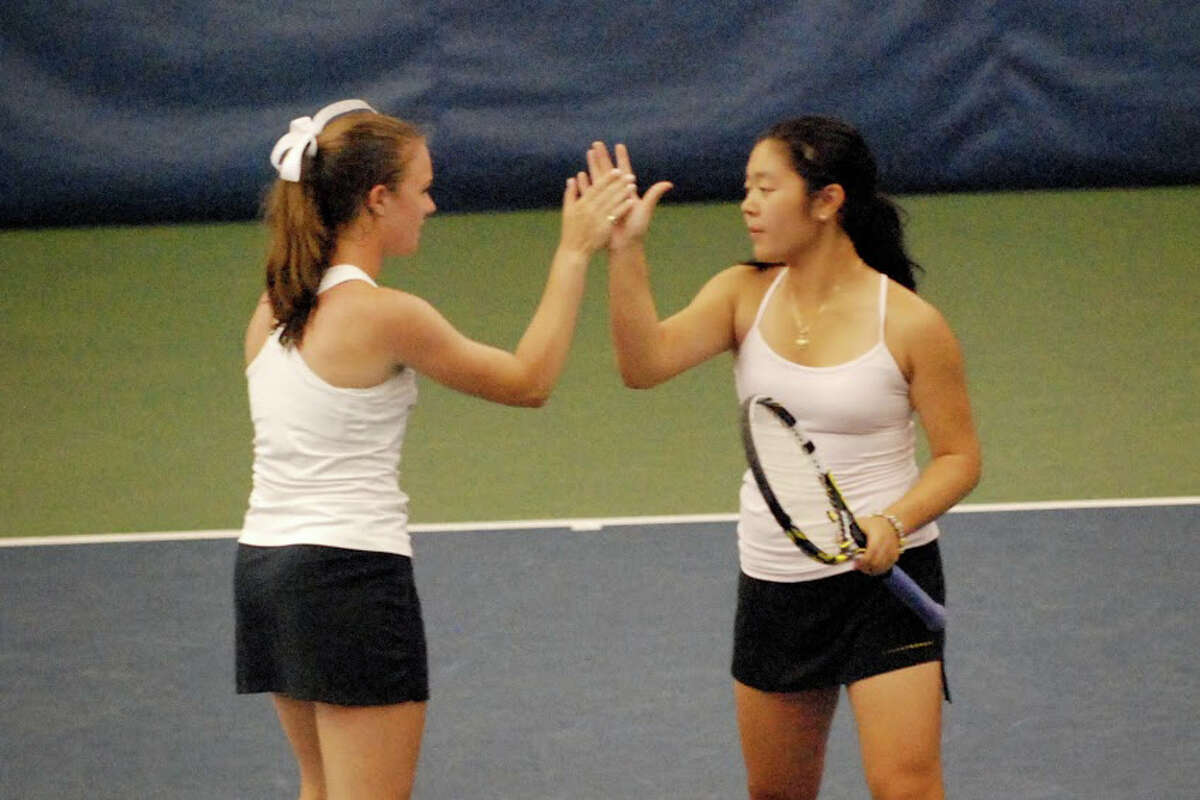 The Staples doubles team of senior Kelsey Shockey, left, and freshman Vanessa Mauricio advanced to the State Open final with a 6-4; 4-6; 7-5 win over Fairfield Warde's Megan and Erin Hines on Tuesday.