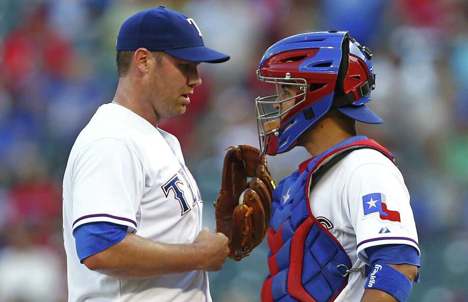 Texas Rangers starting pitcher Colby Lewis, left, and catcher Robinson Chirinos talk in the first inning on Tuesday, June 10, 2014, in Arlington, Texas. (Ron Jenkins/Fort Worth Star-Telegram/MCT) Photo: Ron Jenkins, McClatchy-Tribune News Service / Fort Worth Star-Telegram
