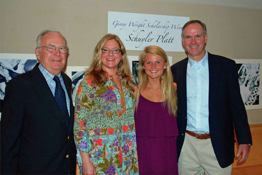 Schuyler Platt, second from right was awarded the 2014 Ginny Wright Scholarship at the 56th annual Darien Art Show & Sale reception. The scholarship is given in memory of Virginia Wright, an artist and DAC volunteer and benefactor, to a Darien High School senior planning to continue the study of visual arts or design in college. Platt will attend Bucknell University in the fall. Her drawings are currently on display in the lobby of the DAC Weatherstone Studio. With her are, from left, Peter Wright; Amy Allen, DAC executive director; and Steven Wright. Photo: Contributed Photo, Contributed / Darien News