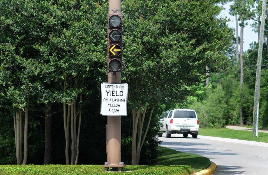 the new left turn signal is operating at the intersection of the Woodlands Parkway at Player Woods Drive. The new blinking yellow arrow is to warn drivers that they should yield to oncoming traffic. Photograph by David Hopper Photo: David Hopper, Freelance / freelance
