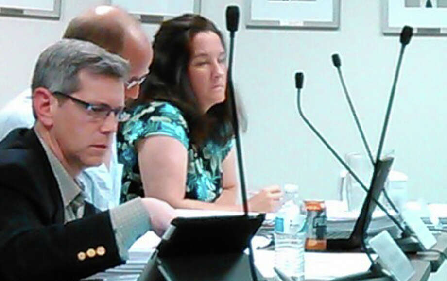Board of Education members, from left, Marc Patten, John Llewellyn and Jennifer Maxon-Kennelly at Tuesday night's meeting in the Education Center on Kings Highway East. Photo: Andrew Brophy / Fairfield Citizen