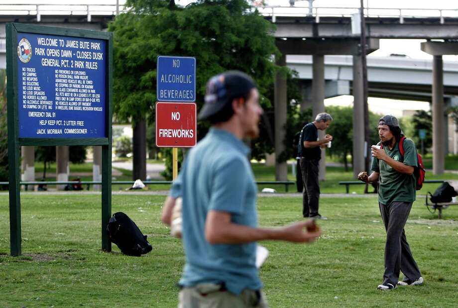 Homeless are feed and listen to preachers at James Bute Park which was formerly known as Frost Town  in the Second Ward on June 4, 2014, in Houston, Tx. ( Mayra Beltran / Houston Chronicle ) Photo: Mayra Beltran / © 2014 Houston Chronicle