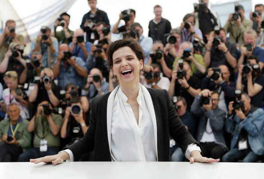 Actress Juliette Binoche laughs as she poses for photographers during a photo call for Sils Maria at the 67th international film festival, Cannes, southern France, Friday, May 23, 2014. (AP Photo/Thibault Camus) ORG XMIT: CAN115 Photo: Thibault Camus / AP