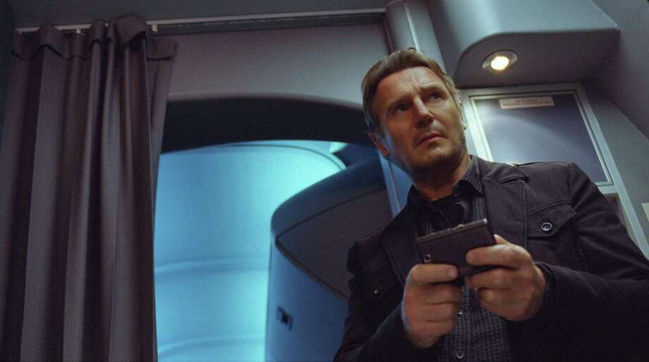 "This image released by Universal Pictures shows Liam Neeson in a scene from ""Non-Stop."" (AP Photo/Universal Pictures) ORG XMIT: NYET913 / Universal Pictures"