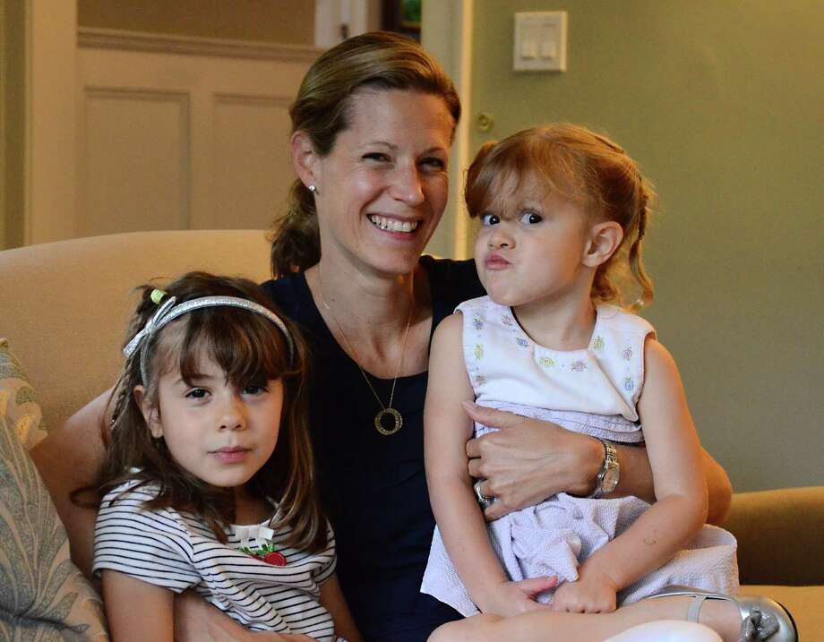 Abigail Skidmore and her two daughters, Nancy, left, and Charlotte, at a photo in her Wahackme Road home in New Canaan, Conn., Wednesday, June 11, 2014. Skidmore, who grew up in Texas, moved to New Canaan from New York last year and is among hundreds of new residents who moved here between 2010 and 2013. Photo: Nelson Oliveira / New Canaan News
