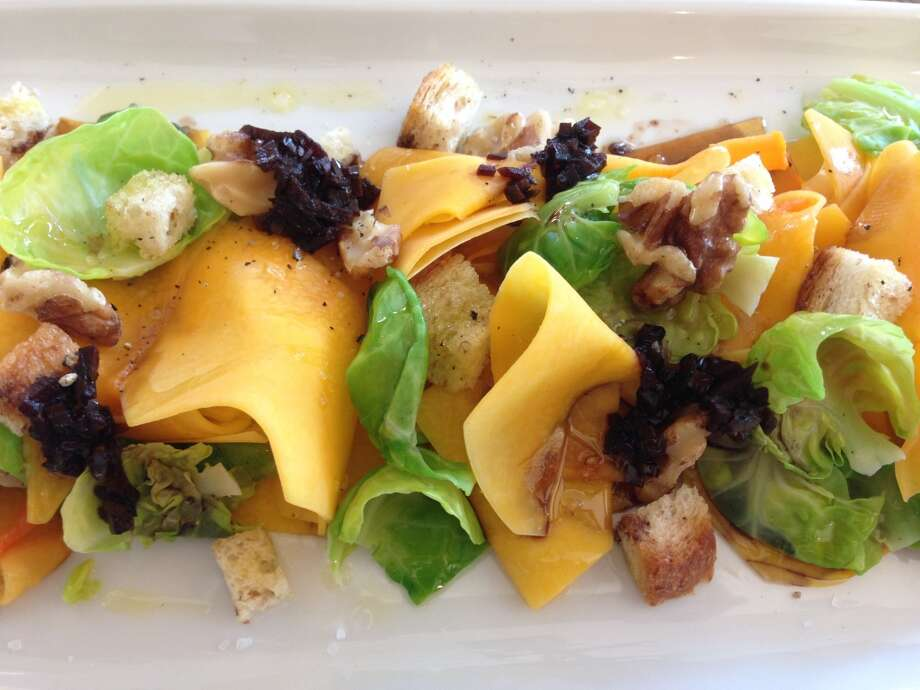 Salad of pickled butternut squash, Brussels sprouts, walnuts and croutons at Coltivare. (Photo: Greg Morago)