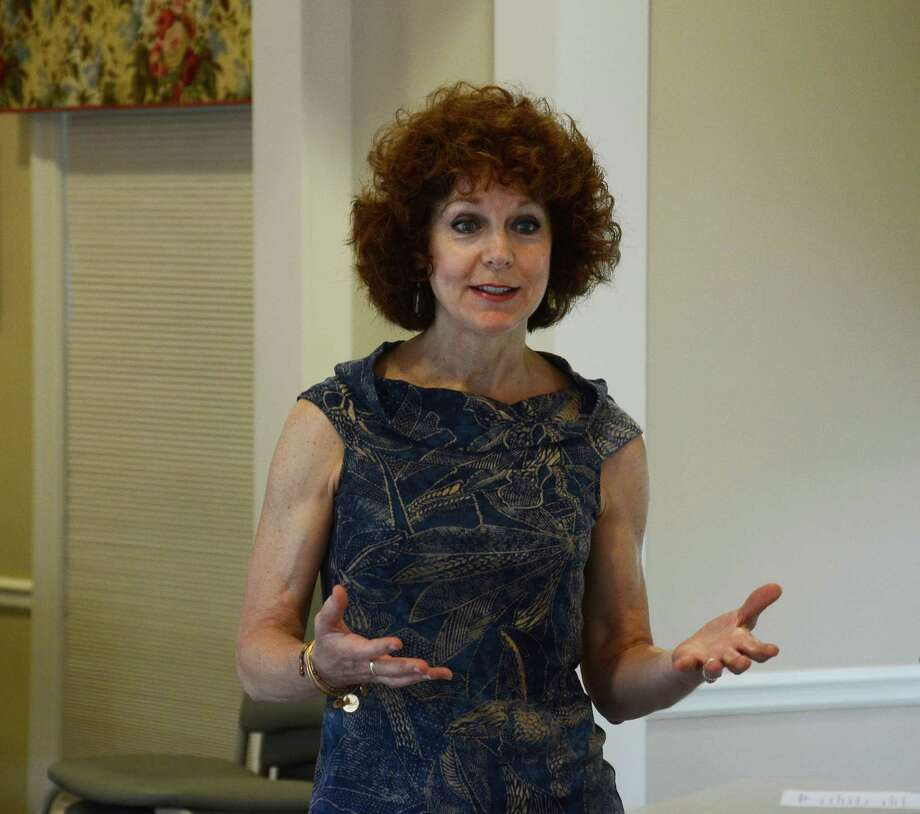 Jane Doe No More's founder Donna Palomba speaks at a New Canaan Domestic Violence Partnership meeting Wednesday, June 4, 2014, at the Lapham Community Center in New Canaan, Conn. Palomba survived a sexual assault in her own home in 1993. Photo: Nelson Oliveira / New Canaan News