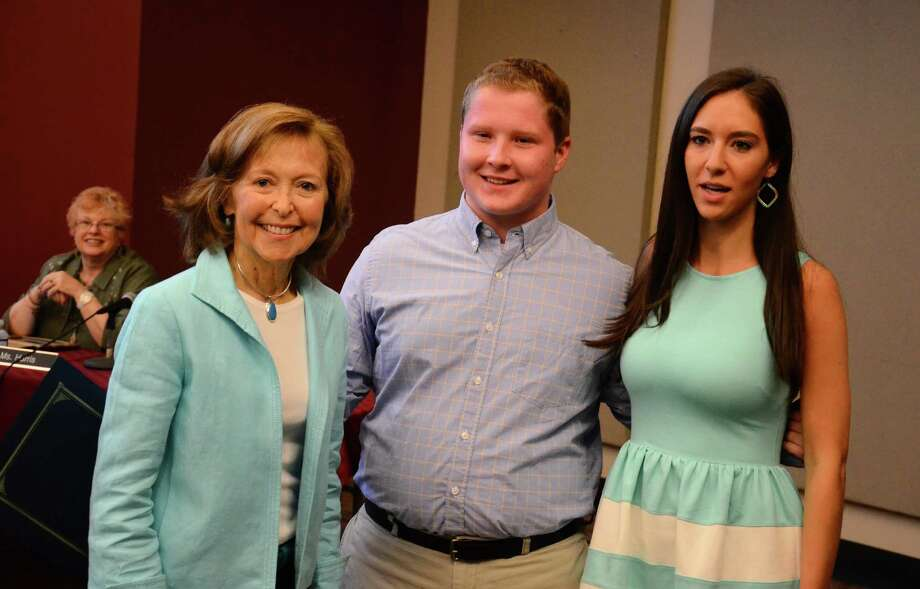 Board of Education Chairman Hazel Hobbs and New Canaan High School seniors Jack Robey and Kit Mallozzi during a board meeting Monday, June 2, 2014, at New Canaan High School, in New Canaan, Conn. Robey and Mallozzi received this year's Connecticut Association of Boards of Educationís student leadership award in the district. Photo: Nelson Oliveira / New Canaan News