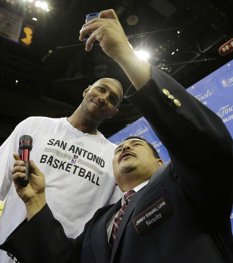 San Antonio Spurs forward Boris Diaw agrees to join a selfie photo with late-night personality Guillermo from the Jimmy Kimmel show after basketball practice on Wednesday, June 4, 2014 in San Antonio.  (AP Photo/Eric Gay) Photo: Eric Gay, Associated Press
