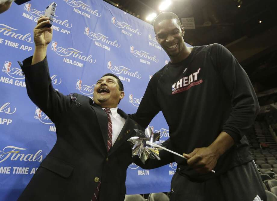 Miami Heat center Chris Bosh, right, jokes with late show personality Guillermo. Photo: Eric Gay, Associated Press