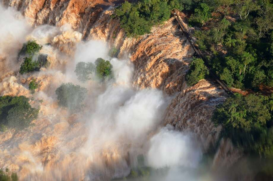 An aerial photo released by the Iguazu National Park, shows the Iguazu Falls in Puerto Iguazu, Argentina, on June 9, 2014.  Photo: Raul Puentes, Associated Press