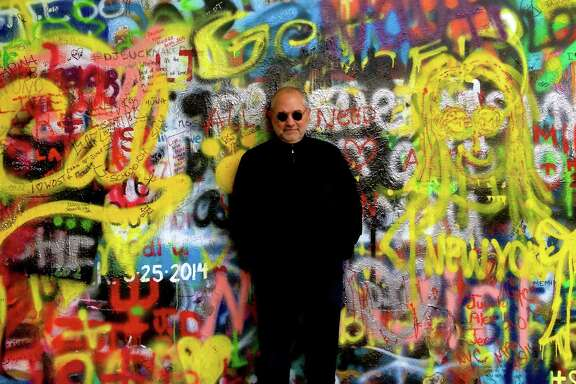 Bob Cavnar in front of the John Lennon wall in Prague in May 2014.
