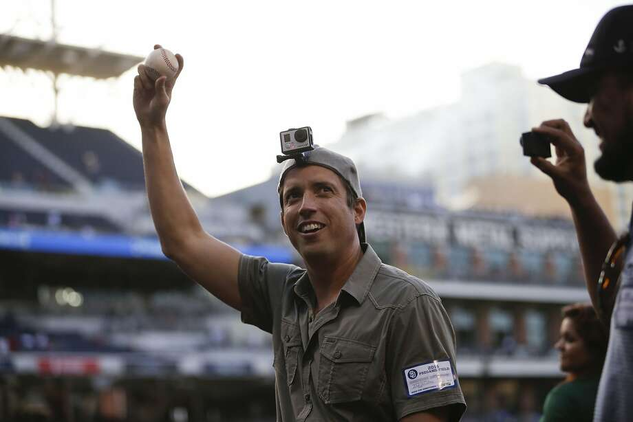 Nick Woodman, the founder and CEO of GoPro, wears a camera on his head before throwing out a ceremonial first pitch before the San Diego Padres play the Washington Nationals in a baseball game Friday, June 6, 2014, in San Diego. (AP Photo/Gregory Bull) Photo: Gregory Bull, Associated Press