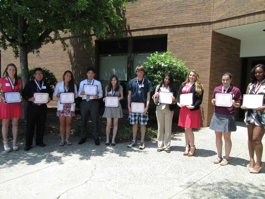 These students were among the 34 area high school juniors honored by Fairfield University and Sikorsky for achievement in math and science. From left to right: Jaclyn Brewster from Lauralton Hall in Milford; Thomas Hong from Bunnell High School in Stratford; Cameron Hummerstone from Fairfield Ludlowe High School in Fairfield; Rami Kharbouch from Bassick High School in Bridgeport; Brittany Kuznitz from Trumbull High School in Trumbull; Shane McVeigh from Fairfield Warde High School in Fairfield; Anjali Pillai from Kolbe-Cathedral High School in Bridgeport; Charlene Pires from Central Magnet High School in Bridgeport; Emily Robertson from St. Joseph High School in Trumbull; and Franceine Welcome from Warren Harding High School in Bridgeport. Photo: Contributed Photo / Connecticut Post Contributed