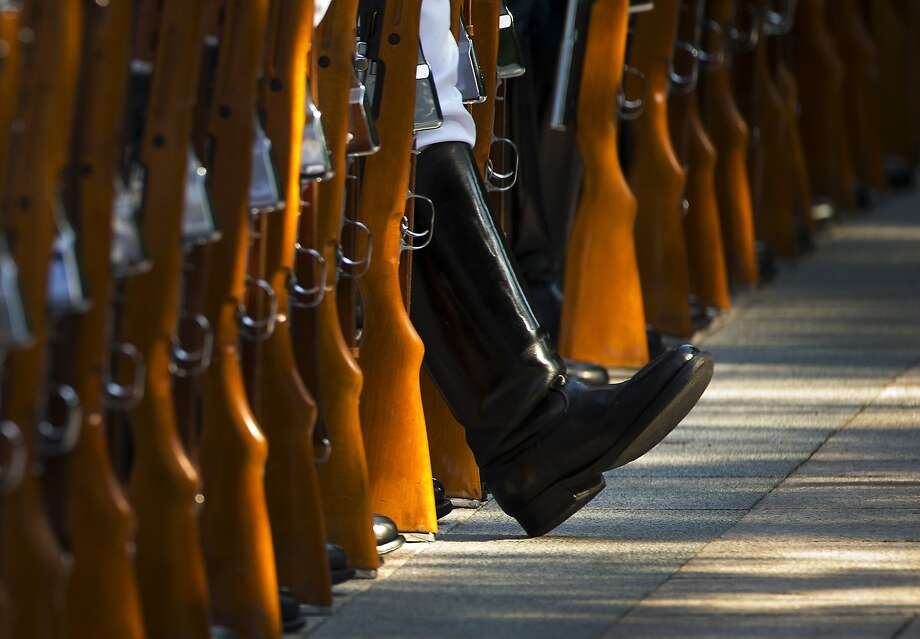 Breaking ranks: A member of a guard of honor stretches his leg as he and his comrades prepare to welcome visiting Italian Prime Minister Matteo Renzi outside the Great Hall of the People in Beijing. Photo: Andy Wong, Associated Press