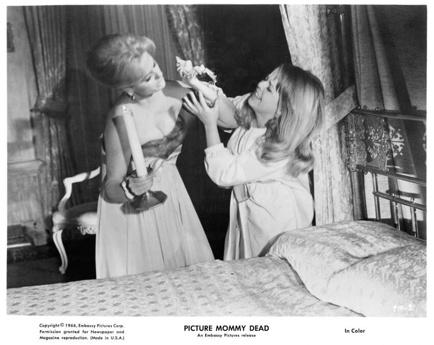 Martha Hyer fights Susan Gordon in a scene from the film