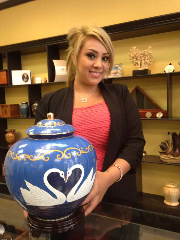Marlene Ortuno, of Distinctive Life Cremations and Funerals in Sugar Land, shows a companion urn with a swan motif. Check out these other distinctive funeral options.