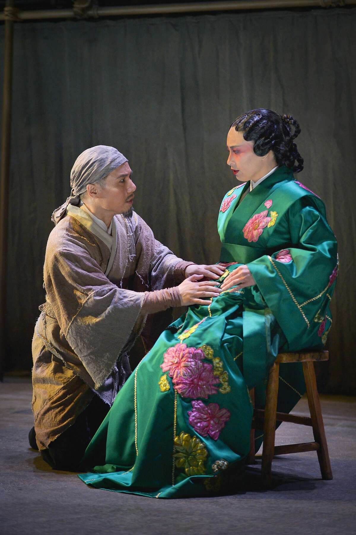 """Country doctor Cheng Ying (BD Wong, left) is summoned by the Princess (Marie-France Arcilla) to deliver her child in American Conservatory Theater's """"The Orphan of Zhao."""""""
