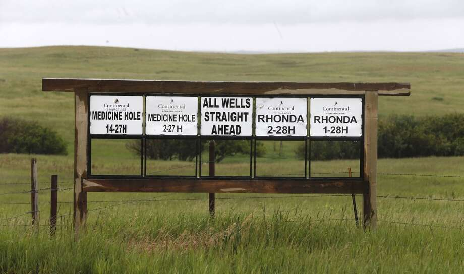 "Signs point to oil well locations near the historical Killdeer Mountian historic battlefield near Killdeer, N.D. An archaeology survey was conducted on the battlefield for a utility company that wanted to run new power lines through the Killdeer Mountain site, but Indian tribes feared the project could disturb the remains of native people who were killed there. The firm hired by the Basin Electric Power Cooperative found ""nothing of consequence"" along a 150-foot right of way. Photo: Charles Rex Arbogast, Associated Press"