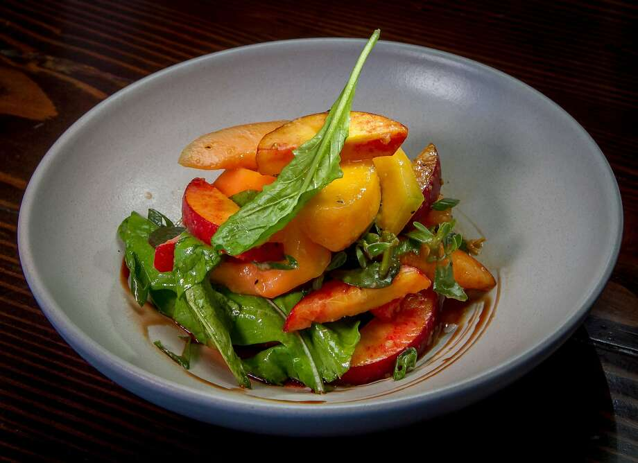The Chaais Melon Salad With Arugula Peaches And Spring Onion At Molina Photo
