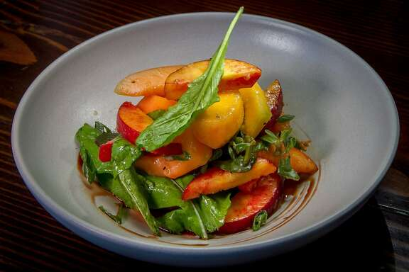 The Charentais Melon salad with arugula, peaches and spring onion at Molina in Mill Valley,  Calif., is seen on Sunday, June 8th, 2014.