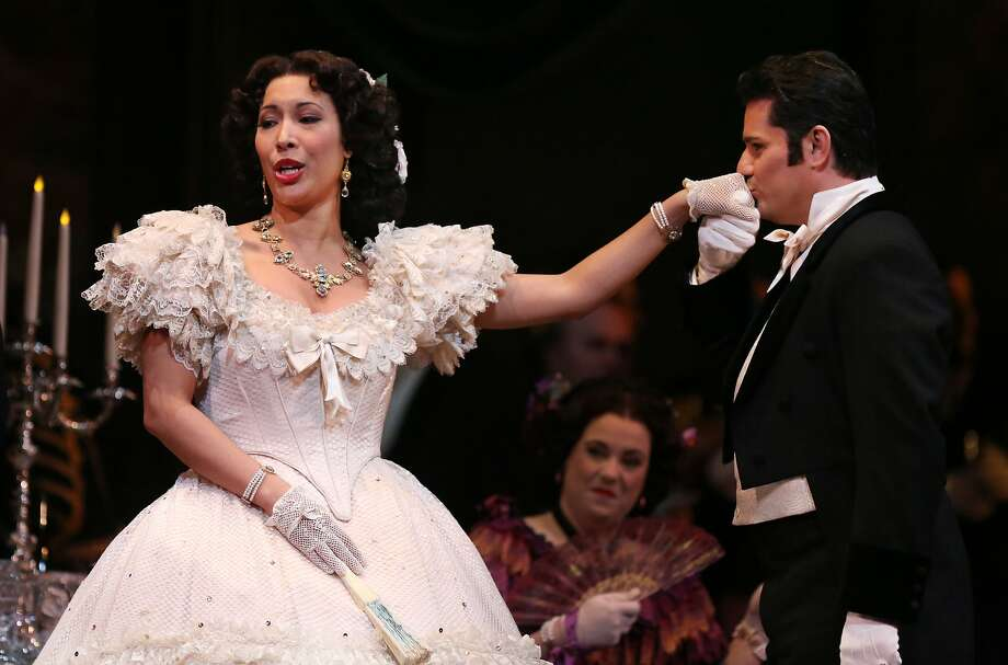 "Soprano Nicole Cabell, as Violetta, and tenor Saimir Pirgu, as Alfredo, try to inflame passion in San Francisco Opera's listless production of Verdi's Parisian love affair ""La Traviata."" Photo: Kevin N. Hume, The Chronicle"