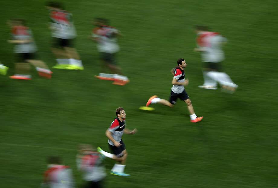 Croatian players warm up during an official training session on Wednesday to prepare for the opening World Cup match on Thursday against Brazil at Itaquerao Stadium in Sao Paulo. Photo: Felipe Dana, Associated Press