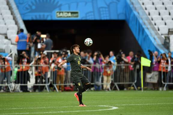 Brazil's forward Neymar plays with a ball during a training session of the Brazilian team at the Corinthians Arena in Sao Paulo, on June 11, 2014, on the eve of a Group A football match between Brazil and Croatia during the 2014 FIFA World Cup.  AFP PHOTO / VANDERLEI ALMEIDAVANDERLEI ALMEIDA/AFP/Getty Images