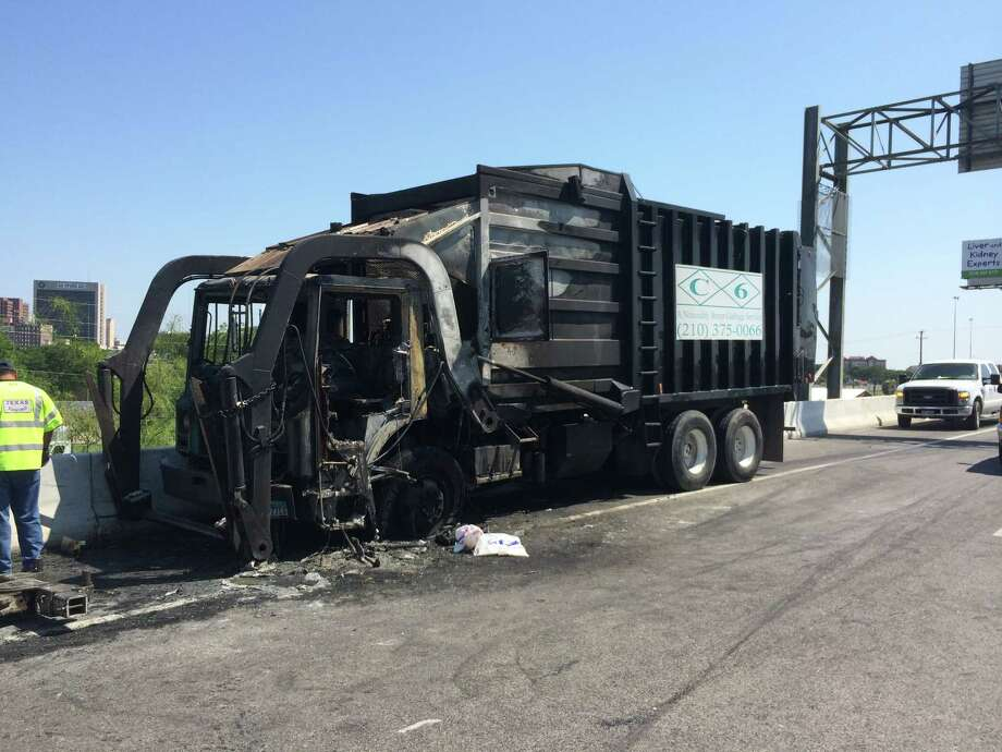 A garbage truck is seen after its contents caught fire while the truck was traveling north on Interstate 35 near McCullough Avenue on Wednesday, June 11, 2014. Oil leaked from truck for about a quarter mile. Photo: Mitchell Ferman / San Antonio Express-News