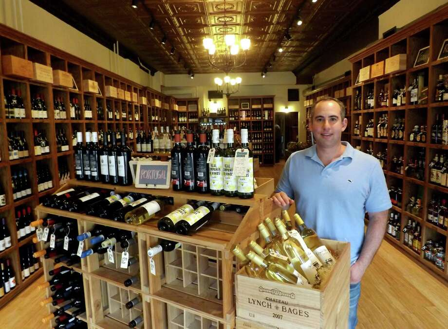 Robert Zalkin, owner of Old Greenwich Fine Wines at 195 Sound Beach Ave. in Greenwich, Conn., offers a full selection of wines, spirits and craft beers. The store opened in late May, replacing the former AOC Wine, which closed over the past winter. Photo: Tim Loh / Greenwich Time