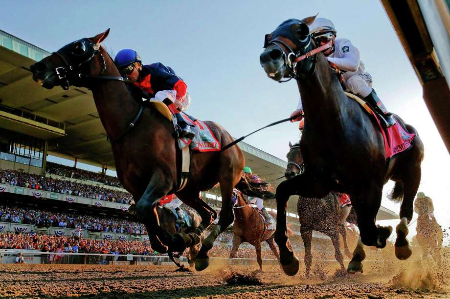 Tonalist, left, owned by Greenwich resident Robert Evans, edges out Commissioner to win the 146th running of the Belmont Stakes horse race, Saturday, June 7, 2014, in Elmont, N.Y. Photo: Matt Slocum, Matt Slocum/Associated Press / Associated Press