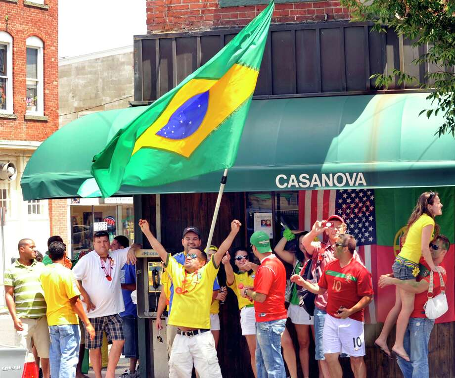 Soccer fans celebrate on Main Street in Danbury in 2010 after the Portugal vs. Brazil World Cup game ended in a tie. Photo: Michael Duffy, ST / The News-Times