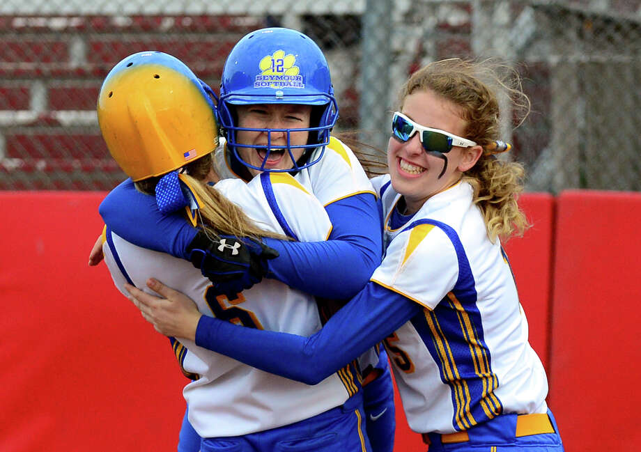 Seymour's Makayla O'Hara, center, celebrates with teammates after bringing in the winning run, during Class M softball Semi-final action against Rocky Hill in Stratford, Conn. on Tuesday June 10, 2014. Photo: Christian Abraham / Connecticut Post