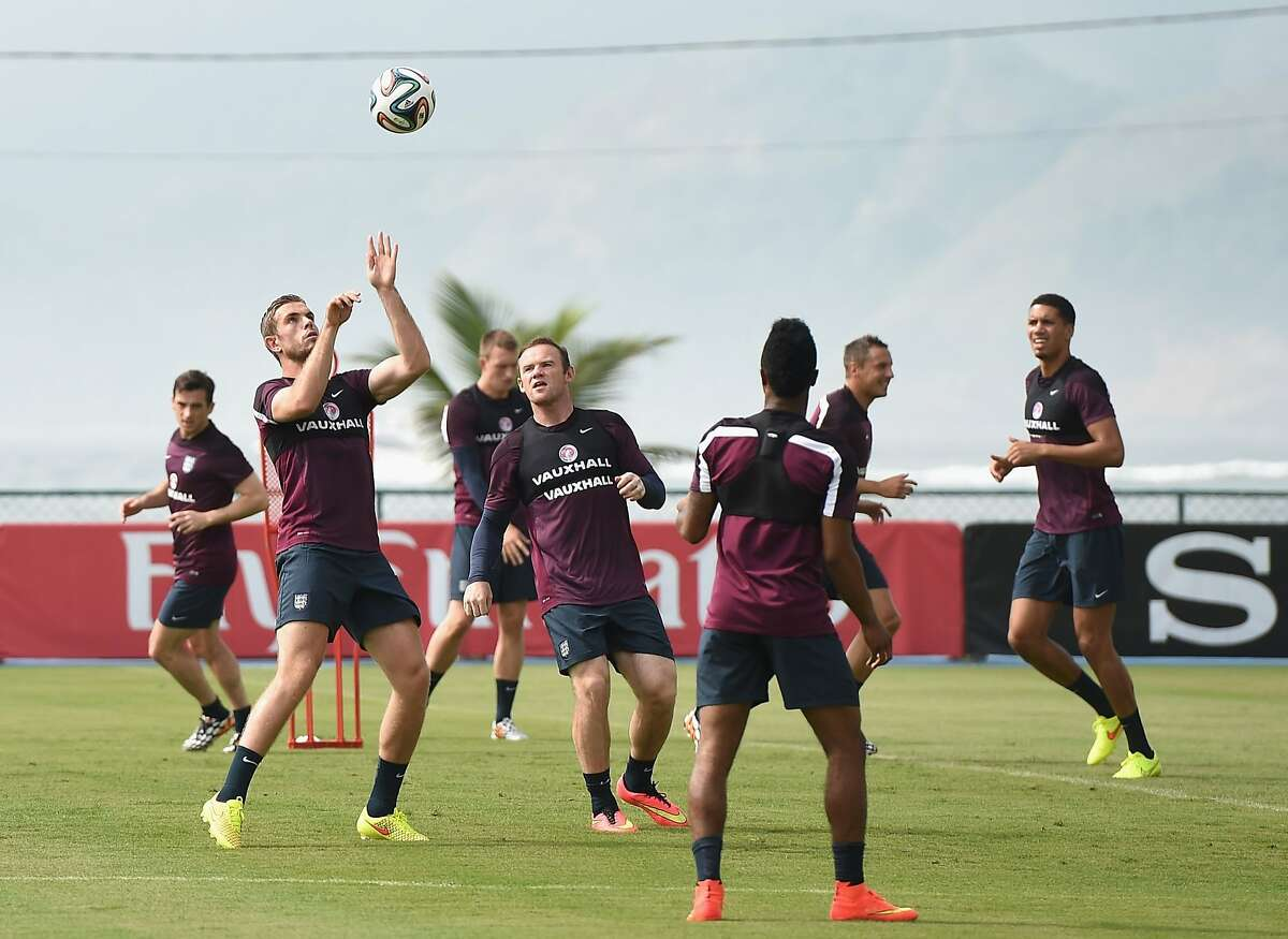 RIO DE JANEIRO, BRAZIL - JUNE 11: Jordan Henderson and Wayne Rooney in action during the England training session at the Urca Military Base on June 11, 2014 in Rio de Janeiro, Brazil. (Photo by Richard Heathcote/Getty Images)