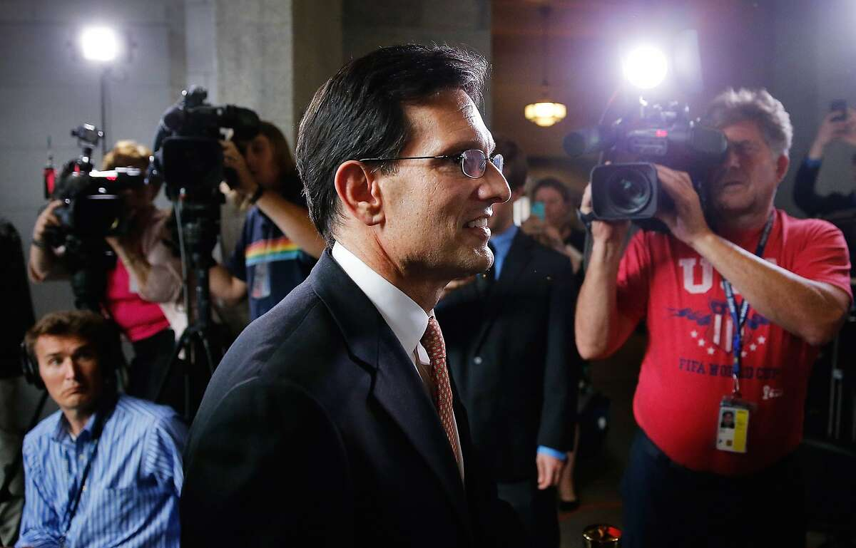 WASHINGTON, DC - JUNE 11: House Majority Leader Eric Cantor (R-VA) departs a news conference after telling the Republican caucus that he will resign his post at the U.S. Capitol June 11, 2014 in Washington, DC. Cantor announced that he will resign his leadership position in the House of Representatives on July 31 after losing a primary race to Tea Party-backed college professor David Brat. (Photo by Win McNamee/Getty Images)