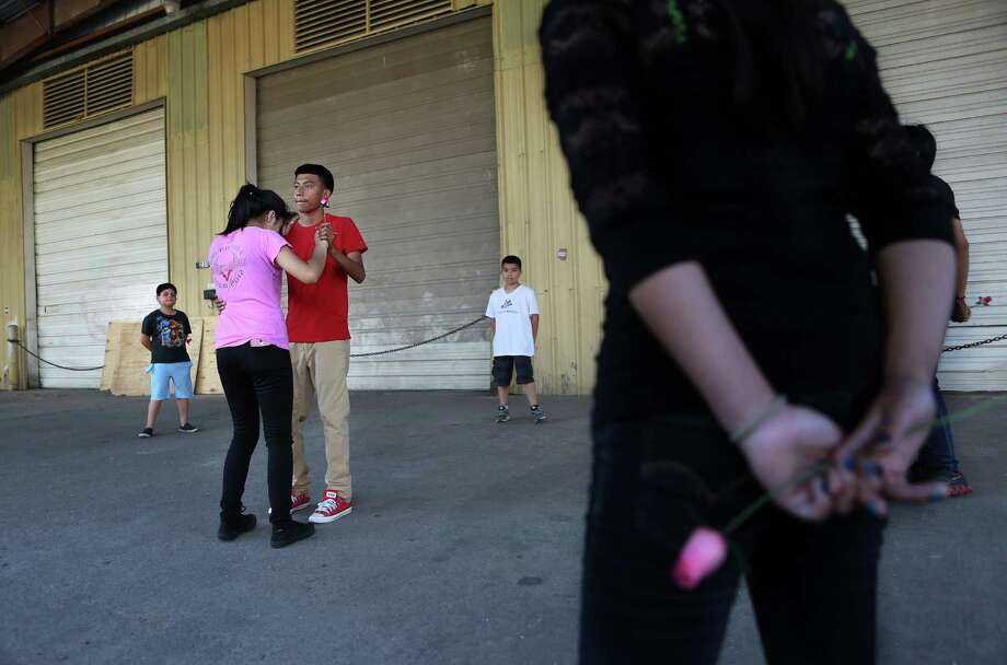 Quinceanera Beranice Baltazar, 14, rehearses the waltz with Horacio Lagunas, 15, along Ennis and Navigation in the Second Ward on June 5, 2014, in Houston, Tx. Photo: Mayra Beltran, Houston Chronicle / © 2014 Houston Chronicle