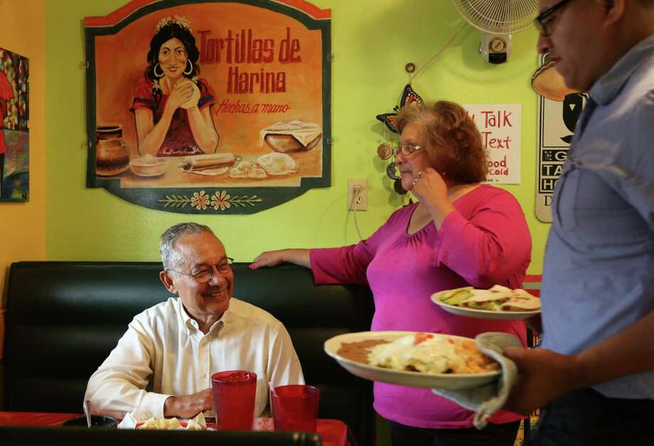 Felix Fraga, a long time Second Ward resident, speaks with Anna Hernandez, owner of Dona Maria along Navigation Blvd. on June 3, 2014, in Houston, Tx. Photo: Mayra Beltran, Houston Chronicle / © 2014 Houston Chronicle