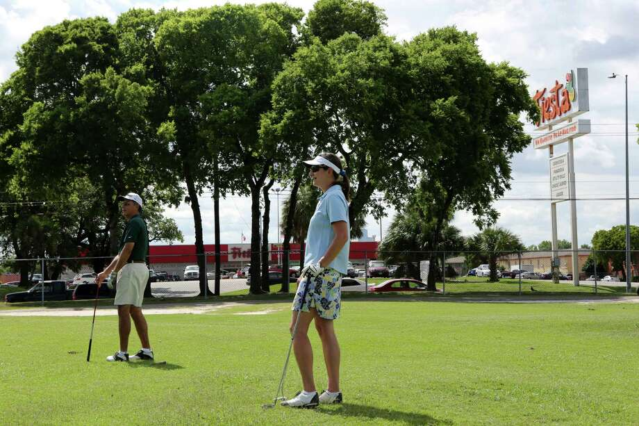 Andrew Sanchez and wife Joyce Sanchez play at Gus Wortham Golf Course in the East End, but residents of the Second Ward have strong feelings about the future of the golf course on June 3, 2014, in Houston, Tx. Photo: Mayra Beltran, Houston Chronicle / © 2014 Houston Chronicle