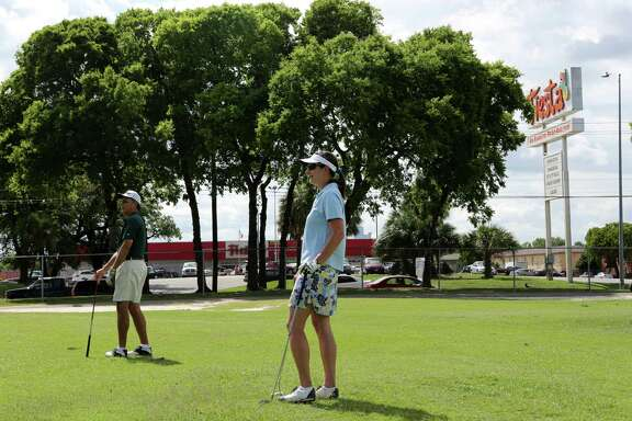 Andrew Sanchez and wife Joyce Sanchez play at Gus Wortham Golf Course in the East End, but residents of the Second Ward have strong feelings about the future of the golf course on June 3, 2014, in Houston, Tx.