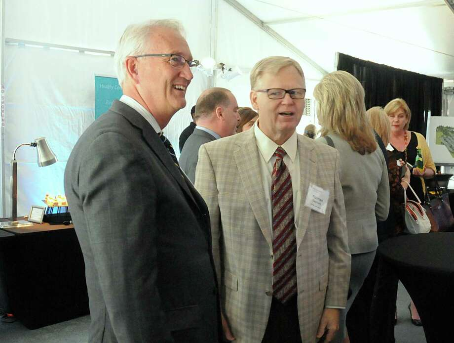 Randy Penn, St Luke's Foundation member, and Norman Stephens, President Vintage Hospital, watch the proceedings during the groundbreaking ceremony for CHI St. Luke's Health Springwoods Village medical complex. Photo: David Hopper, For The Chronicle / freelance