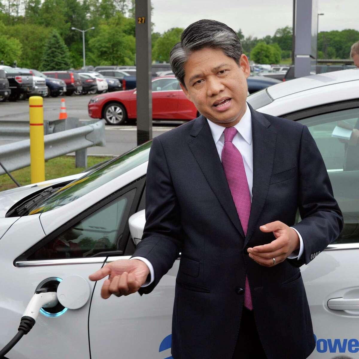 Gil Quiniones, president and CEO of NYPA, unveils new electric vehicle charging stations at Albany International Airport Wednesday, June 11, 2014, in Colonie, N.Y. (John Carl D'Annibale / Times Union)