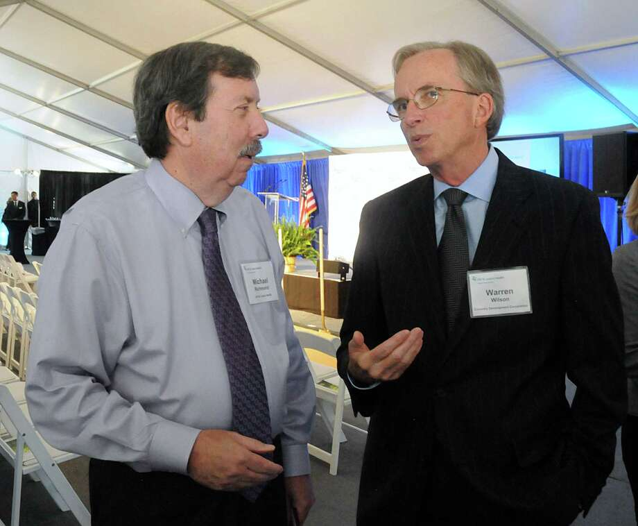 Michael Richmond, chairman board of directors CHI St. Luke's Health-The Woodlands Hospital, visits with Warren Wilson during the groundbreaking ceremony for CHI St. Luke's Health Springwoods Village medical complex. Photo: David Hopper, For The Chronicle / freelance