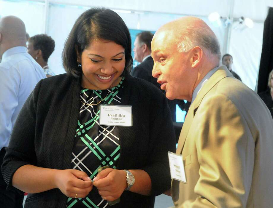 Prathiba Pandian, CHI St. Luke's Health-The Woodlands Hospital project manager, and Howard Tellepsen, Jr., Chairman and CEO Tellepsen Hunt, discuss the groundbreaking ceremony for CHI St. Luke's Health Springwoods Village medical complex. Photo: David Hopper, For The Chronicle / freelance