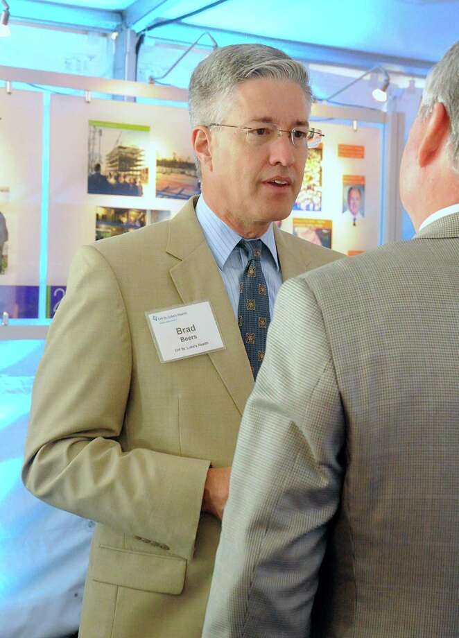 Brad Beers, board member CHI St. Luke's Health-The Woodlands Hospital, visits with guests during the groundbreaking ceremony for CHI St. Luke's Health Springwoods Village medical complex. Photo: David Hopper, For The Chronicle / freelance