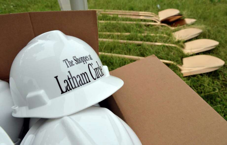 Hard hats and shovels stand ready during groundbreaking ceremonies for the new Shoppes at Latham Circle Wednesday, June 11, 2014, in Colonie, N.Y.  (John Carl D'Annibale / Times Union) Photo: John Carl D'Annibale / 00027246A