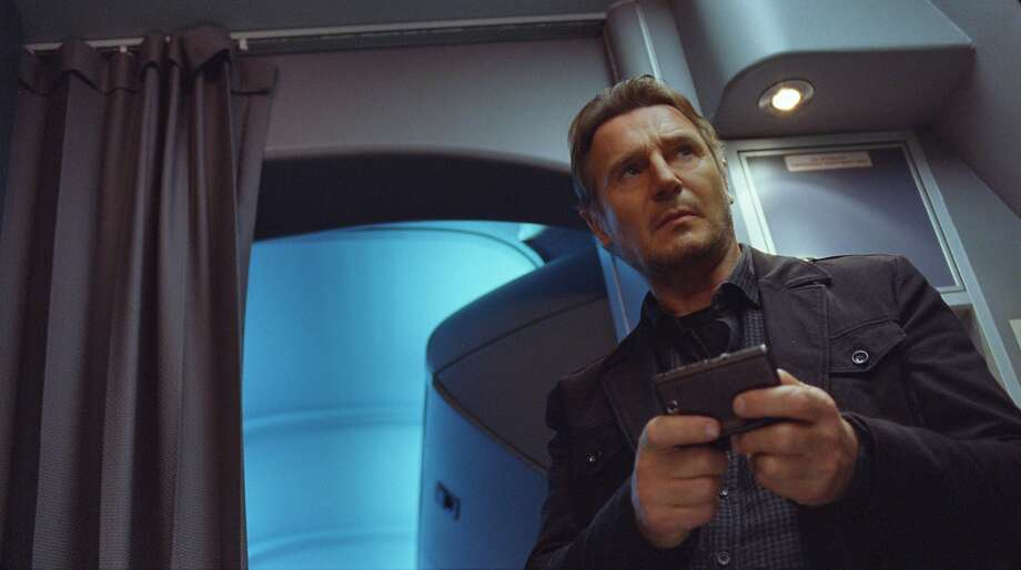 "Liam Neeson as an alcoholic air marshal who gets a text threatening to kill passengers in ""Non-Stop."" Photo: Associated Press"