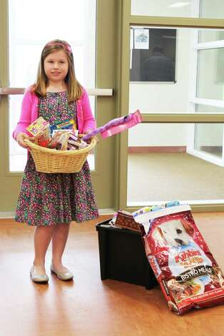 Kylee Church, 8, of Schodack raised more than $200 for the Columbia-Greene Humane Society/SPCA from various sources including bottle deposits and Christmas earnings. She also sold homemade biscuits and handkerchiefs at a family garage sale and painting nails. (Aaron Clause)